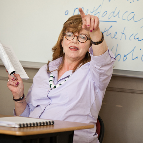 Female faculty member pointing - LG