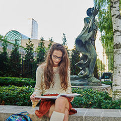 Female Student Studying Outside