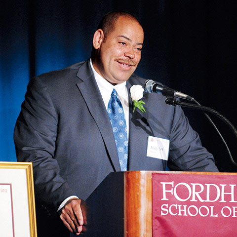 Fordham Law alumnus Andy Hinton '89, vice president of Global Ethics and Compliance at Google, accepts The Richard J. Bennett Memorial Award at the 2013 Corporate Counsel Dinner