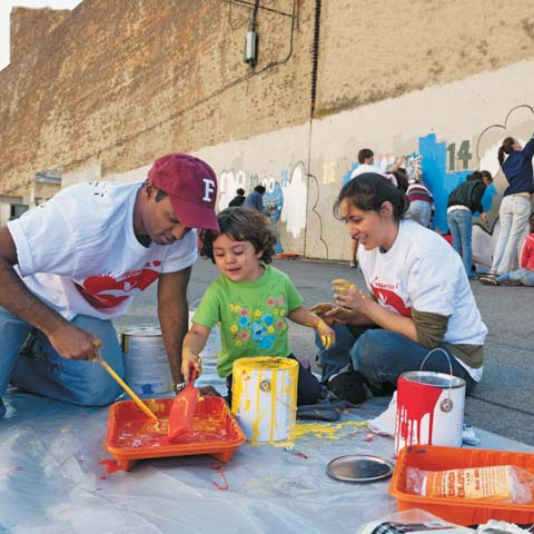 Two students preparing to paint a mural