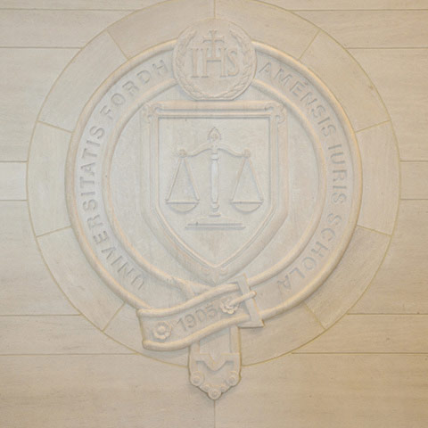 Fordham Law School seal carved in stone in new building lobby