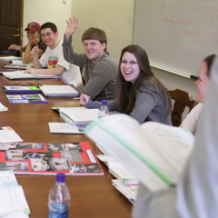 Row of students at conference table - SM