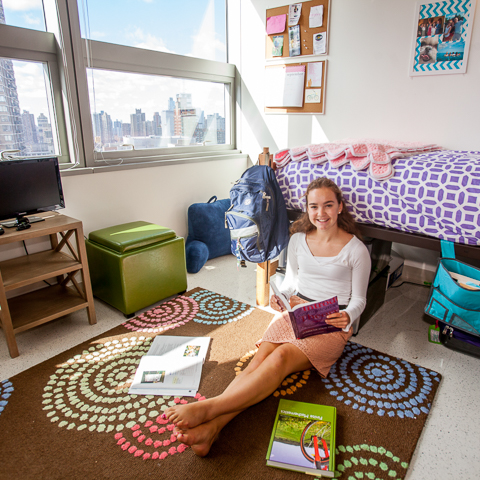 Female student in Lincoln Center Dorm Room