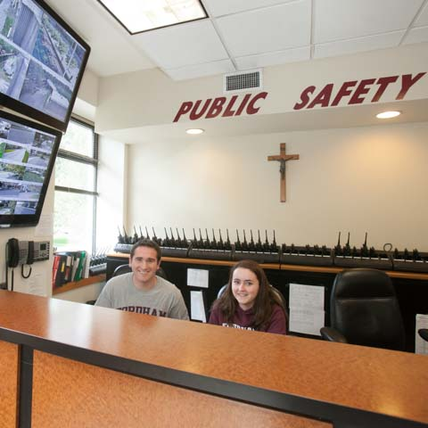 Two students at public safety desk - LG