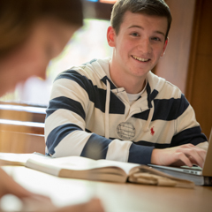 Male student in striped shirt smiling at camera - SM