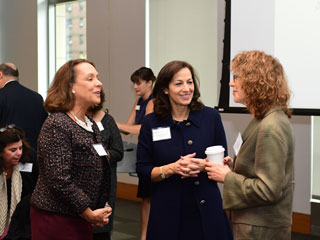 Susan Salice talking with other attendees before speaking