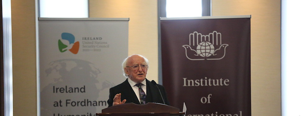 Speaker Michael D. Higgins standing at the podium delivering a lecture for the Ireland at Fordham Humanitarian Lecture Series