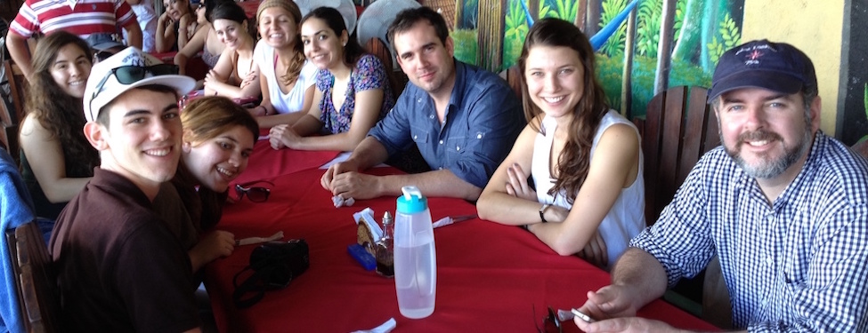 Group of students sitting around a lunch table in Nicaragua during an Institute of International Humanitarian Affairs January break trip