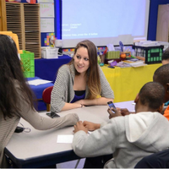 Fordham Law student Sara Gates leads a discussion with students from P.S. 191