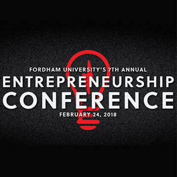Entrepreneurship Conference white logo on black background with red light bulb