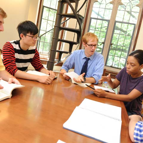 Professor and Two Students at Conference Table