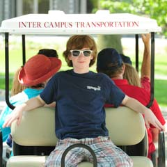 Young Boy on Golf Cart