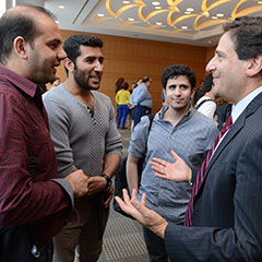 Fordham Law Dean Matthew Diller chats with students at an event