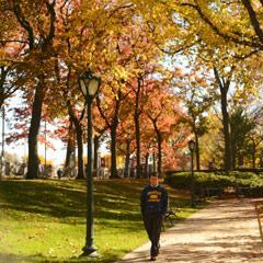 Fall Student Walks by Edward's Parade