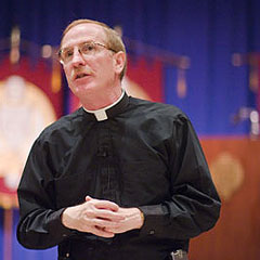 Father McShane Addresses Faculty at Convocation