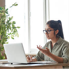 Image of a female talking through computer