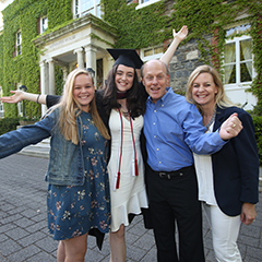 Parents' Leadership Committee members with their daughter at graduation