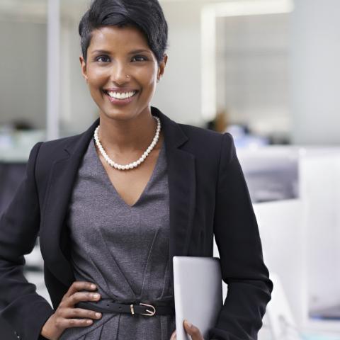 FLS Professional Woman Holding an iPad