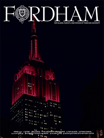 Fordham Magazine Spring 2017 Cover Featuring the Empire State Building Lit in Maroon.