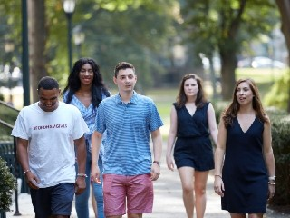 Fordham students walking on campus.