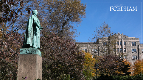 Zoom background with a statue and Rose Hill campus building.