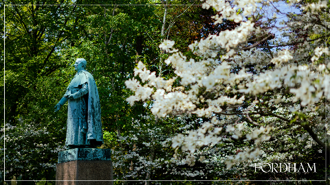 Zoom background with a statue and spring flowers.