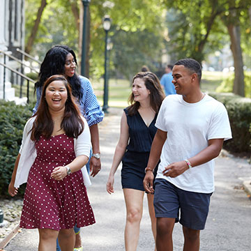 Four students walking at rose hill