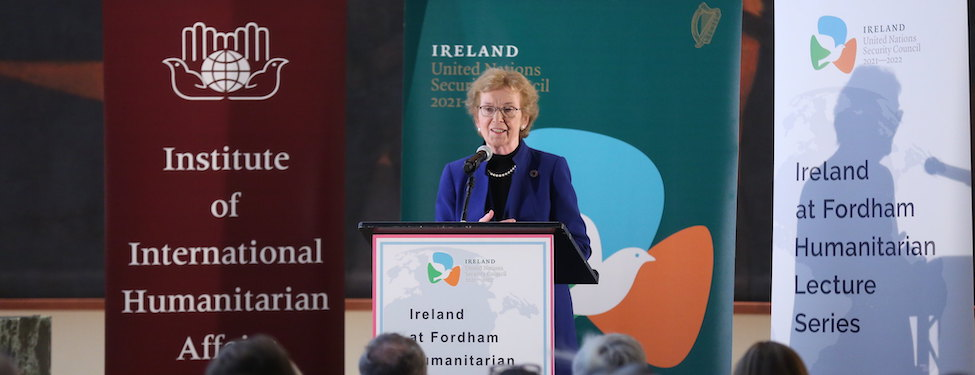 Speaker H.E. Mary Robinson stands at a podium to deliver a speech about the challenges of the humanitarian sector at the United Nations
