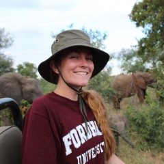 Student on safari with elephants in background