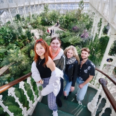 Students stand on staircase in London garden