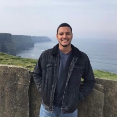 Student stands near cliffs in Ireland