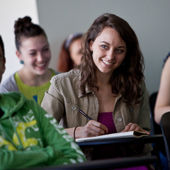 Female Student Smiles in Classroom