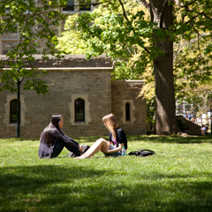 Two students sitting by lawn - SM