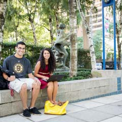Two students sitting in LC plaza - SM