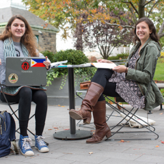 Two Female Students Sitting Outside