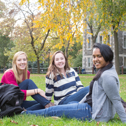 Three female students sitting outside at Rose Hll - LG