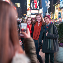 Three Students Getting Photographed in Times Square