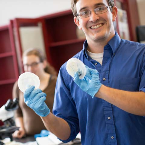Male student with gloves and petri dish - LG