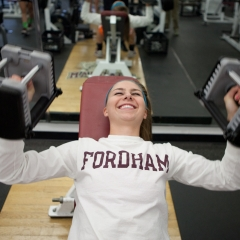 Female student lifting weights - SM