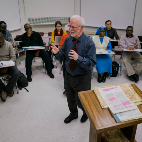 professor teaching graduate students