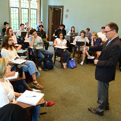 Professor George Demacopoulos teaches a theology class in Duane Library at Fordham's Rose Hill Campus.