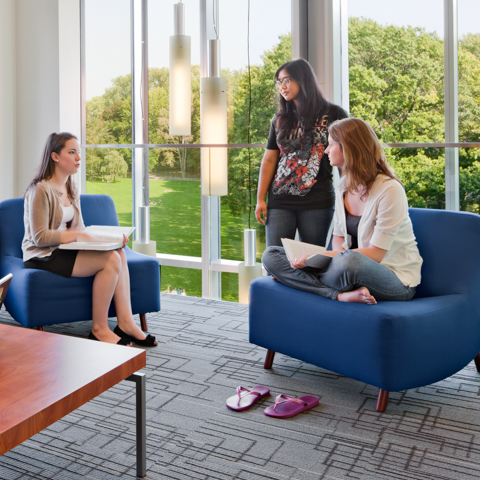 Three Female Students Sitting in Lobby