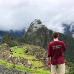 student overlooks Macchu Picchu ancient ruins