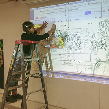 Student Preparing Art with Projector