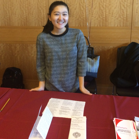 Student Standing at Disability Studies information table