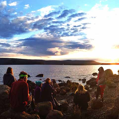 Students Watch Sunrise at Lake in Tasmania