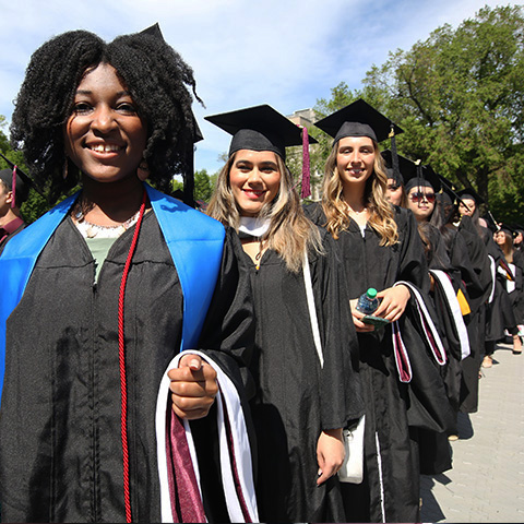 Students standing in line for Commencement