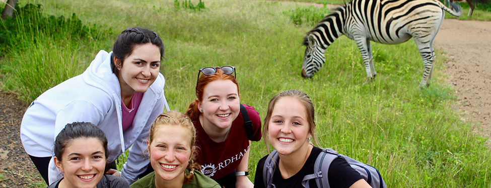 Students in South Africa with zebra in background