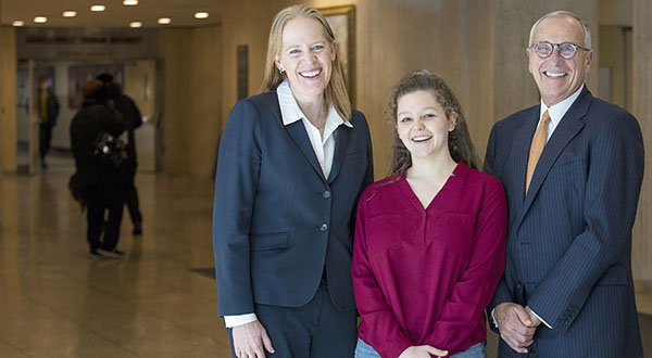 John Toffolon (right), Cindy Vojtech (left), and Samantha Barrett, a first-year student at the Gabelli School