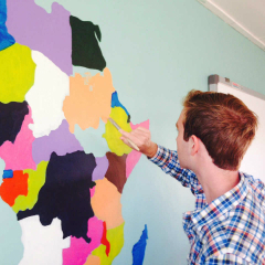 Student Canton Winer paints map of Africa on classroom wall in South Africa